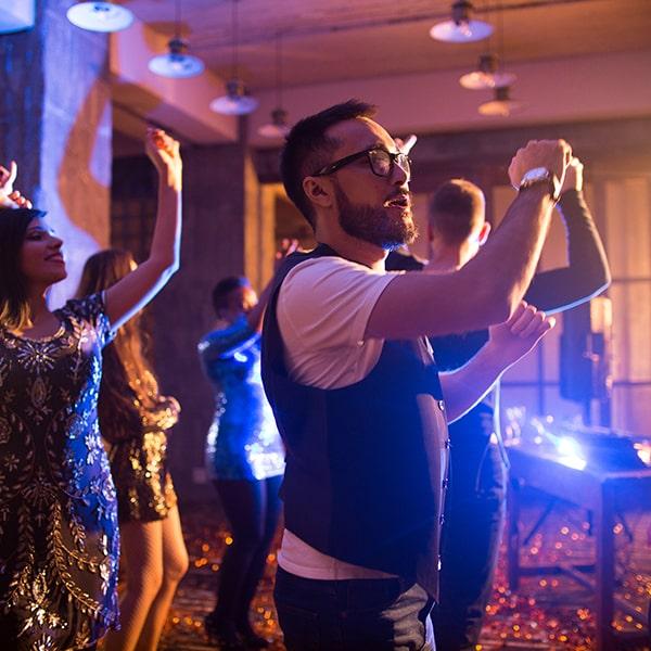 young-man-enjoying-music-in-club-min